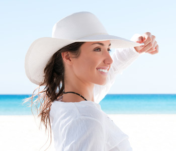 Beautiful girl relaxing and smiling outdoor at summer beach