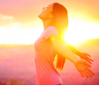 Free happy woman enjoying nature sunset