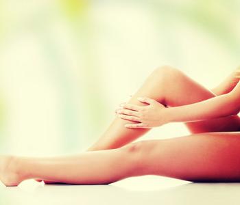 Woman holding on leg