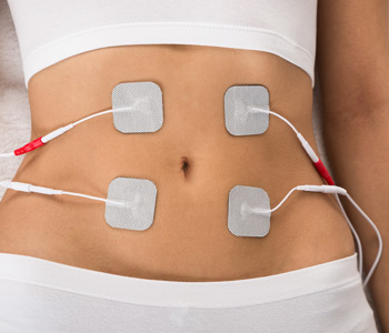 Woman With Electrodes On Her Stomach